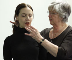 Janice adjusting singer's head and neck posture